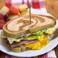 Main ham on rye breakfast sandwich feature 300pz