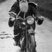 Thumb santa on a motorcycle