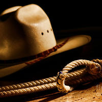Main cowboy hat and lasso olivier le queinec